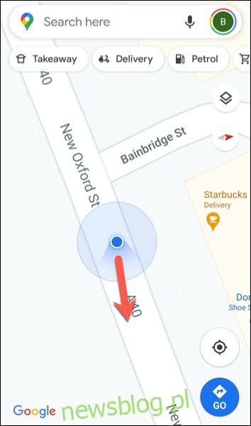 Czerwony symbol to ikona kompasu skierowana na północ.
